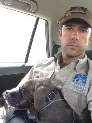 JAFCO Muzzled dog with John Peaveler